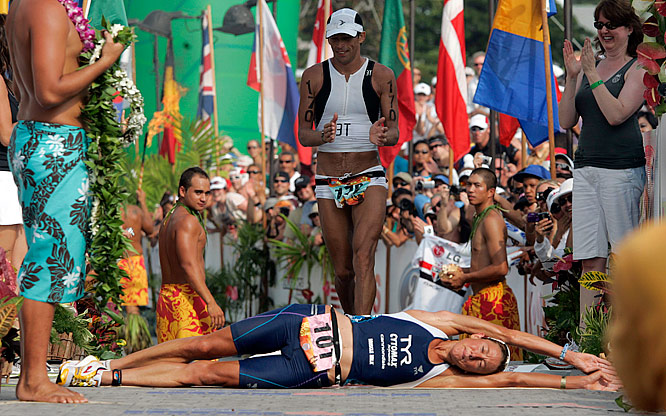Chrissie Wellington of Great Britain rolls across the finish line at the Ironman World Championship in Kailua-Kona, Hawaii, for her third consecutive victory. Wellington's time of 8:54:02 broke the 18-year-old course record.