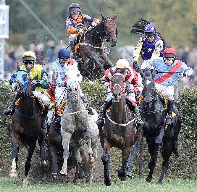 Riders competing during the 119th traditional Velka Pardubicka Steeplechase in East Bohemia.
