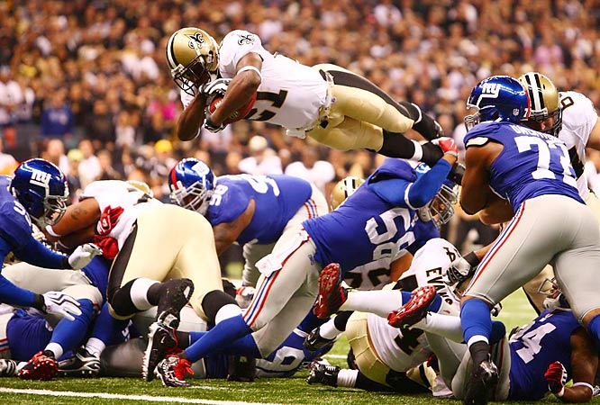 New Orleans running back Mike Bell dives for a touchdown on a fourth-and-one play at the two-yard line on Sunday in New Orleans. The Saints defeated the Giants 48-27.