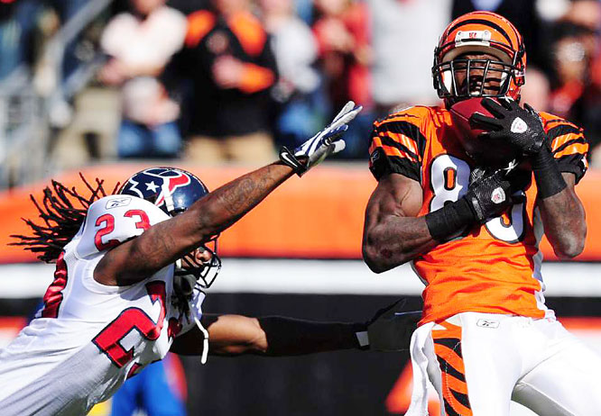 Cincinnati receiver Chad Ochocinco makes a catch while under pressure from Houston's Dunta Robinson at Paul Brown Stadium in Ohio. The Texans defeated the Bengals 28-17.