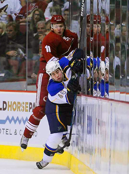 Phoenix Coyotes center Martin Hanzal slams St. Louis Blues defenseman Roman Polak into the boards during their game at Jobing.com Arena in Glendale, Ariz. The Coyotes defeated the Blues 3-2 in overtime.