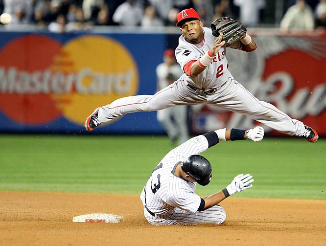 Alex Rodriguez is forced out at second as Erick Aybar throws to first base for a double play in Game 6 of the ALCS. New York won 5-2 to advance to the World Series.