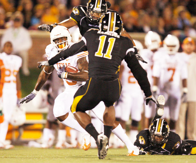 Texas wide receiver Malcolm Williams eyeballs Missouri safety Jarrell Harrison during their game October 24 at Memorial Stadium in Columbia, MO. Texas defeated Missouri 41-7.