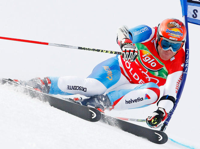Switzerland's Didier Cuche speeds to the fastest time during the first run of an World Cup giant slalom race in Soelden, Austria.
