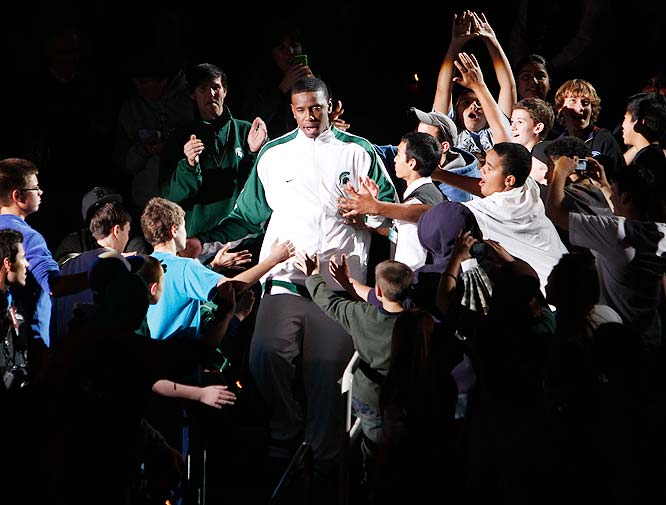 Michigan State's Raymar Morgan makes his way through a crowd of adoring fans after being introduced for the Spartans' Celebrate the Moment practice.