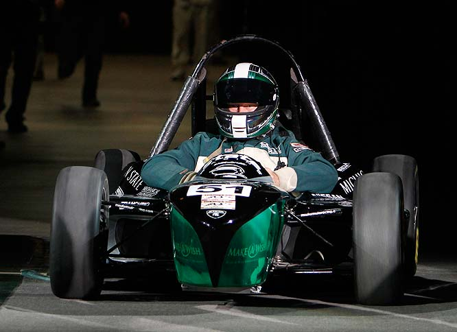 In true Midnight Madness fashion, Michigan State Tom Izzo made his entrance in an F1 car.