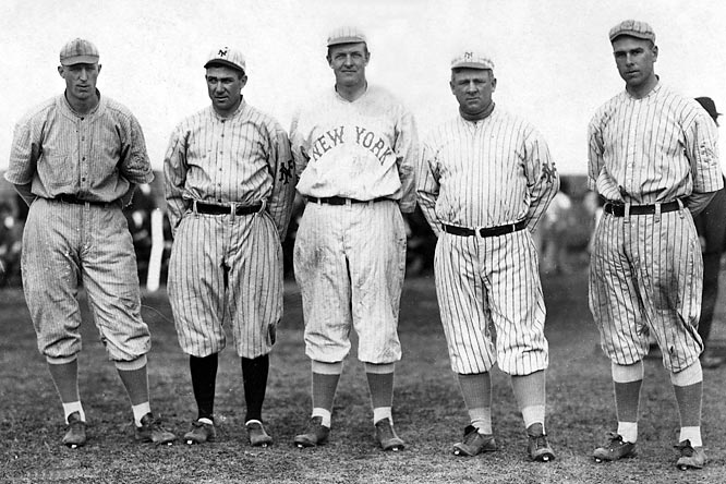 Pictured (left to right) are Fred Merkle, Larry Doyle, Christy Mathewson, manager John McGraw and Fred Snodgrass. Because Game 2 ended in a controversial tie due to darkness, the 1912 World Series between the Red Sox and Giants went to a decisive Game 8 tied 3-3-1. With Christy Matthewson going the distance at Fenway Park, the Giants broke a 1-1 tie with a run in the top of the 10th, but first baseman Merkle, catcher Chief Myers and Matthewson let a foul pop off the bat of Tris Speaker fall between them. Speaker capitalized on the second chance with a game-tying single. Two batters later, a sac fly won the Series for Boston.