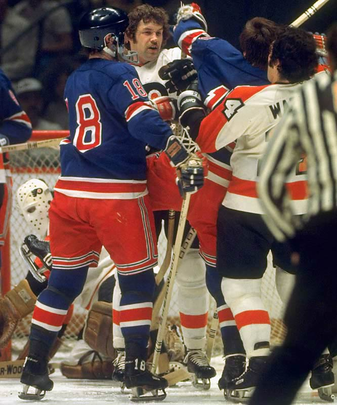 "In the 1974 playoffs, Dave ""The Hammer"" Schultz took down the Rangers' Dale Rolfe while the rest of Rangers stood watching the beat down.  The Rangers lost on and off the ice that night, falling to the Flyers 4-3.  Defeating the Rangers in seven games, the Flyers then brought the Cup to Philadelphia for the first time after beating the Bruins in the finals."