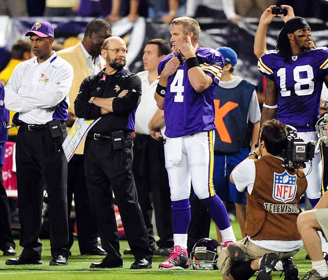 Give credit to Minnesota coach Brad Childress (dressed in black) for staying persistent until he got Favre signed.