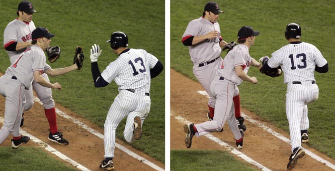 In a pivotal play during Game 6 of the ALCS, Alex Rodriguez is ruled out for interference after slapping the ball from Red Sox pitcher Bronson Arroyo's glove. As a result Derek Jeter, who had scored, is ordered back to first with two outs rather than one, killing a potential rally in New York's eventual 4-2 loss to Boston.