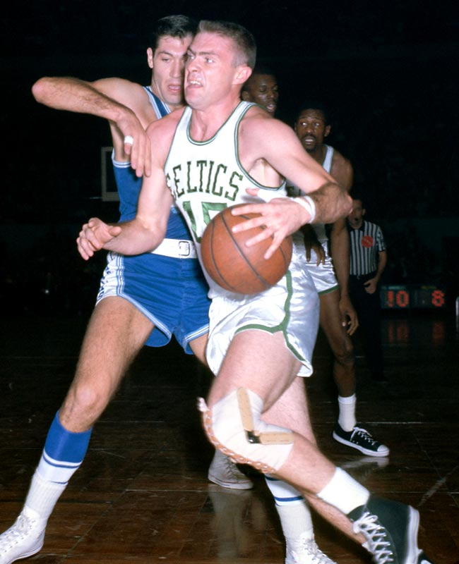Tom Heinsohn makes his debut for the Boston Celtics during a 115-112 victory over the New York Knicks.
