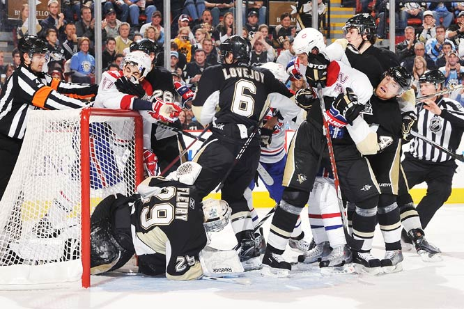 The Pittsburgh Penguins and the Montreal Canadiens tangle on Nov. 25 at Mellon Arena in Pittsburgh. The Penguins won 3-1.