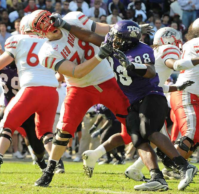 New Mexico tackle Ivan Hernandez attempts to hold off TCU defensive end Jerry Hughes during the Horned Frogs' 51-10 victory over the Lobos on Nov. 28.