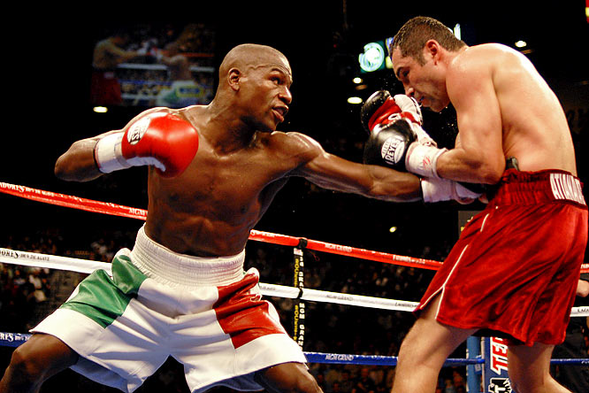 "In the largest pay-per-view fight in history (2.45 million buys), Mayweather moved up to 154 pounds to face six-division champion and WBC super welterweight titlist De La Hoya. The title fight was supposed to ""save boxing,"" but controversy arose as Mayweather earned a split-decision victory when many saw the fight in De La Hoya's favor."