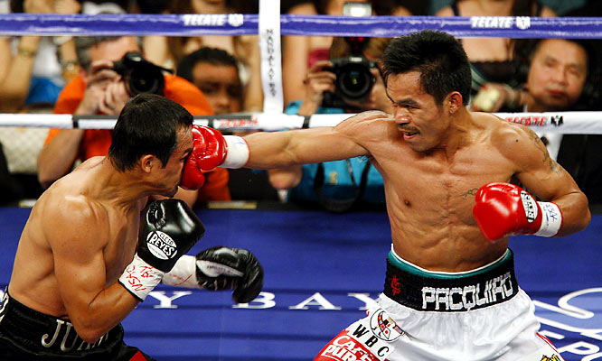 "Their first meeting, a split-decision win in Pacquiao's favor, ended on a sour note, thanks to a judging mistake -- one judge who had it 113-113 admitted making an error on the scorecard. Their rematch, aptly named ""Unfinished Business,"" also ended with a disputed split-decision victory for Pacquiao, who earned his third world title in three divisions. He turned down a third match so he could move to lightweight."