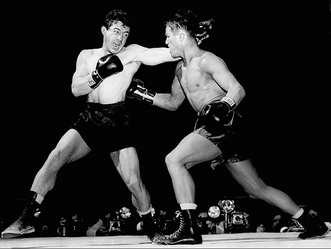 In the second bout in a middleweight trilogy that Red Smith called three of the most two-sided fights ever, Rocky (left) prevailed with a sixth-round KO after being down himself in an all-out war at Chicago Stadium.