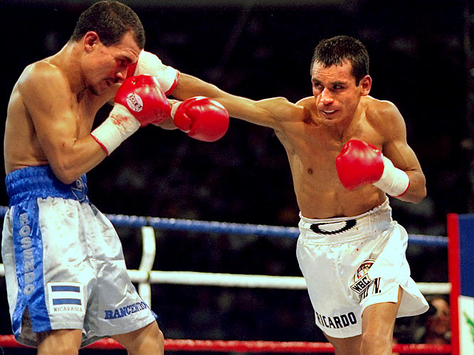 "Mexico's greatest fighter, El Finito won his first world title in 1990 at 106 pounds and retired 11 years later with only a draw against Rosendo Alvarez (whom he beat in a rematch) marring his record. The 5-foot-5 Lopez was a flawless fighter, best described as a ""mini Joe Louis."""
