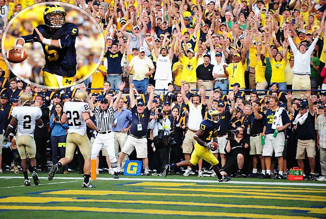 Freshman Tate Forcier hit Greg Mathews for a 5-yard touchdown with 11 seconds to go in just his second career start as the Wolverines rallied to win the highest-scoring game in the series' history.