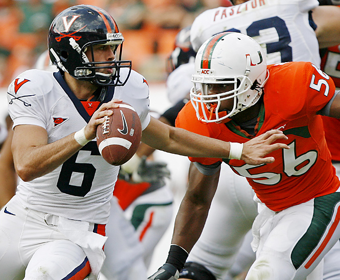 Marcus Robinson (right) helped the Miami defense make life difficult for Virginia quarterback Marc Verica, who completed 11 passes for 75 yards. Graig Cooper rushed for a career-best 152 yards and a touchdown and Damien Berry ran for a pair of second-half scores for 7-2 Miami.