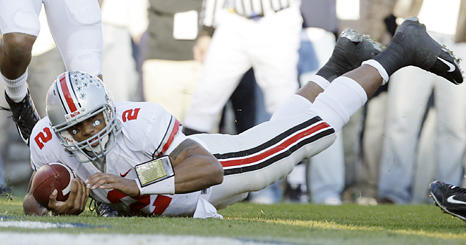 Terrelle Pryor threw for two touchdowns and ran for another in his return to his home state as the Buckeyes secured a tie for the Big Ten conference lead. Ohio State (8-2, 5-1) held Penn State (8-2, 4-2) to 201 total yards and nine first downs.