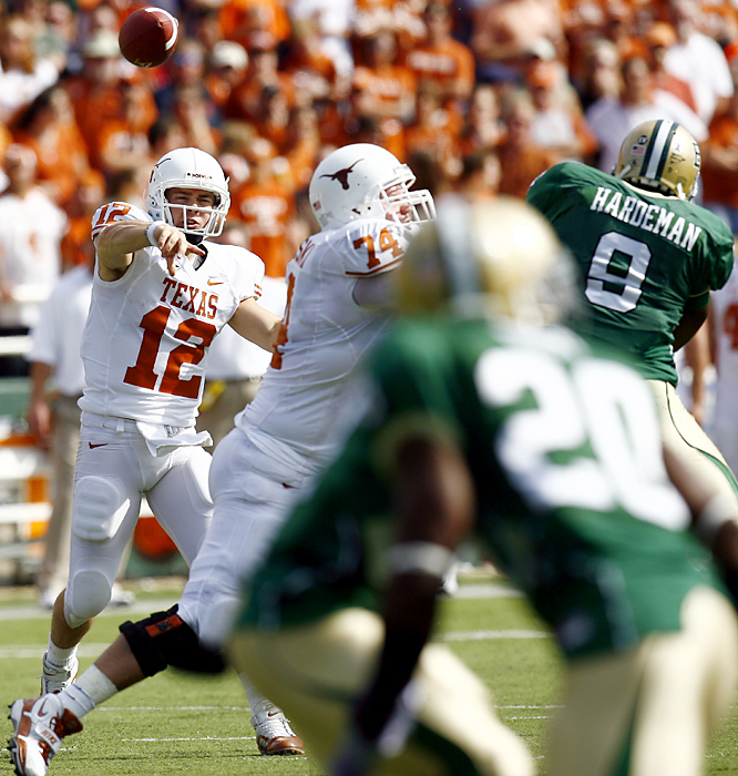 Colt McCoy (left) tied the NCAA record for career victories by a starting quarterback, throwing two touchdown passes to help Texas reach 10 wins for the ninth straight season. McCoy is 42-7 in his career, tying the wins record set by former Georgia quarterback David Greene.