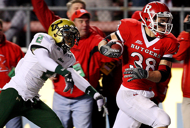 Joe Martinek (right) completes a 37-yard scoring run in the fourth quarter Thursday as the Scarlet Knights embarrassed the error-prone Bulls. Rutgers forced four turnovers, blocked a punt and recorded seven sacks. It marked the first time South Florida was shut out in the regular season in its 13-year history.