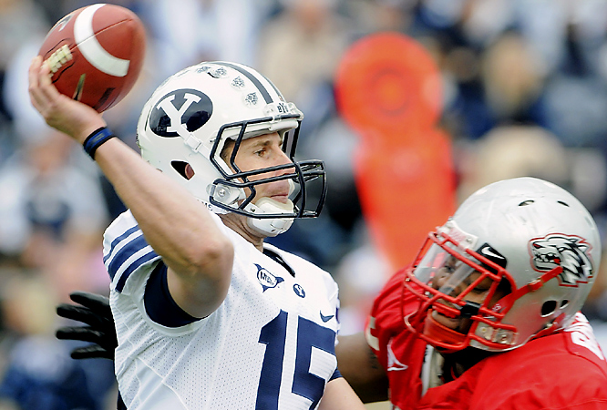 Max Hall (left) passed for two touchdowns and got his 29th victory at BYU to match Heisman Trophy-winner Ty Detmer's school record, and the Cougars survived a sloppy fourth quarter. Hall completed 21 of 33 attempts for 314 yards with one interception as BYU improved to 6-0 on the road this season.