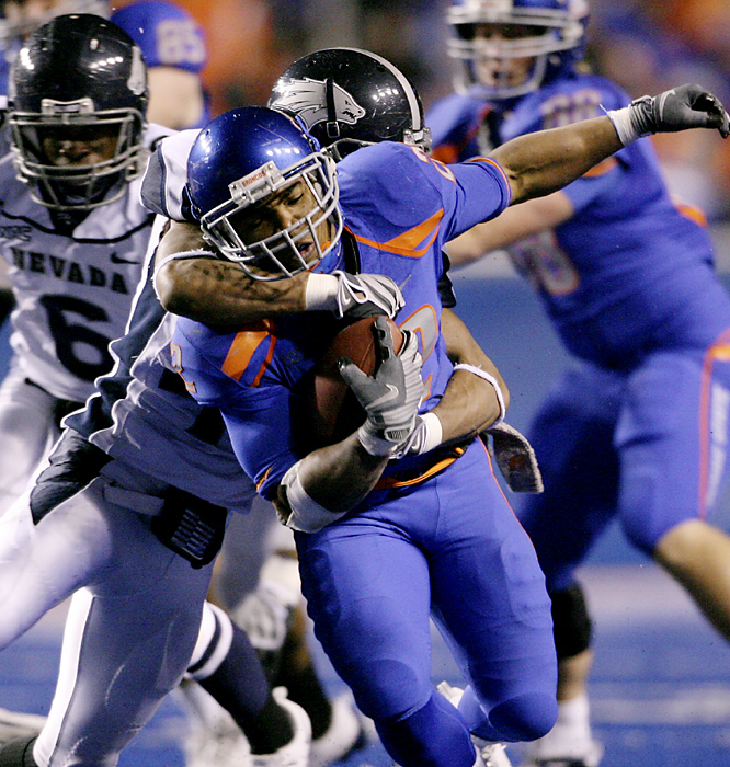 Sophomore Doug Martin (center) rushed for 128 yards and Kellen Moore added five touchdown passes to power Boise State (12-0, 7-0). Boise State locked up at least a share of its seventh WAC championship in eight seasons, pending one more game at home against lowly New Mexico State before BCS bids are announced next weekend. BSU has won 24 straight regular-season games.
