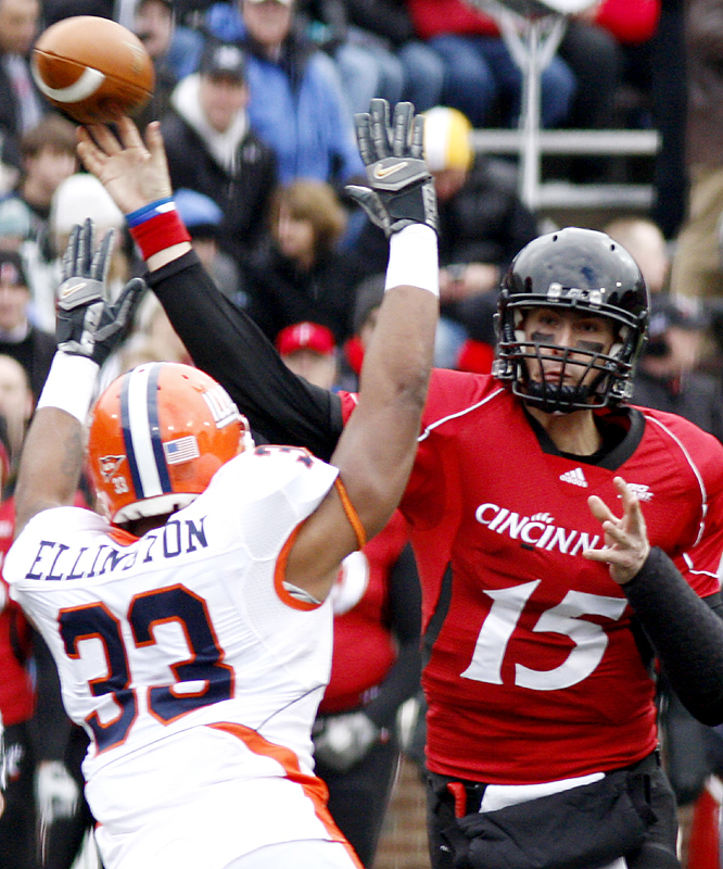 Tony Pike answered all the questions six times over.  The senior returned from a major injury to his non-throwing arm and had a record day Friday, passing for six touchdowns in a victory that kept Cincinnati unbeaten. UC (11-0) remained one of six unbeaten Bowl Subdivision teams, ranked fifth in the BCS standings. The Bearcats finish their regular season next weekend in Pittsburgh, playing for their second straight Big East championship.