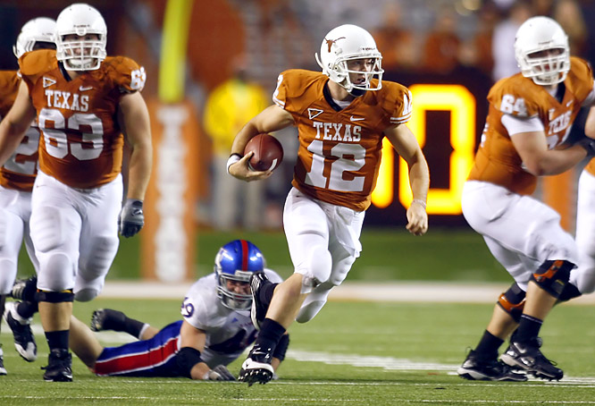Colt McCoy (left) set an NCAA record with his 43rd career victory as a starter, passing for 396 yards as Texas wrapped up the Big 12 South title.