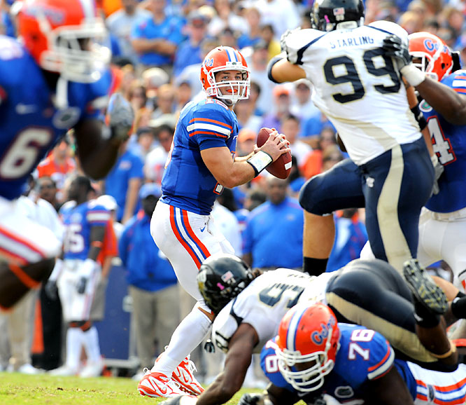 Tim Tebow accounted for three touchdowns and Brandon Spikes returned an interception for a score as top-ranked Florida moved another step closer to perfection.