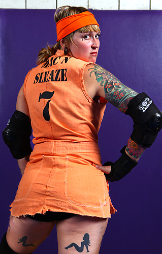 Before her debut with Gotham Girls Roller Derby, Mac-n-Sleaze skated 2 seasons with the Garden State Rollergirls.  She skates the Bocker and Pivot positions.