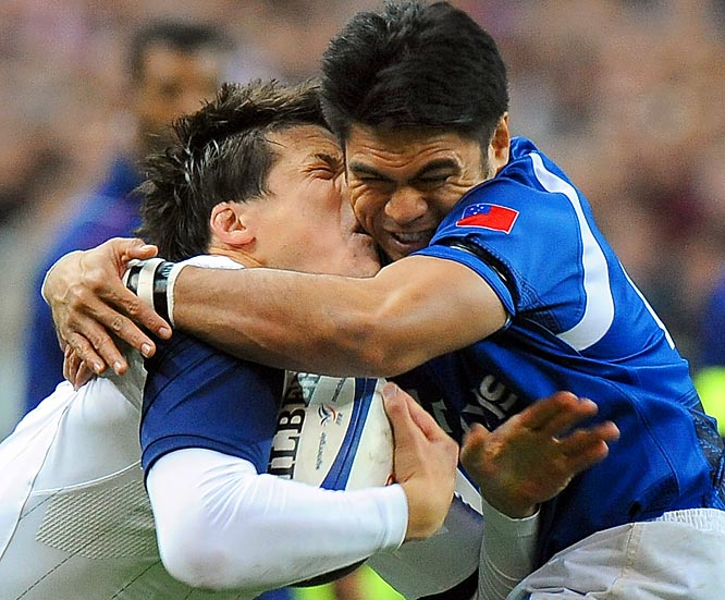Francois Trinh-Duc (left) of France gets his name rearranged while competing against David Lemi of Samoa during a Rugby union test match in Paris, which the home team won 45-3.