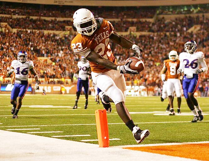 Running back Tre' Newton scores during the Longhorns' 51-20 victory over Kansas on Nov. 21 in Austin, a victory that put Texas within two wins of reaching the national title game. The 'Horns play Texas A&M on Thanksgiving Day and Nebraska in the Big 12 championship game on Dec. 5.