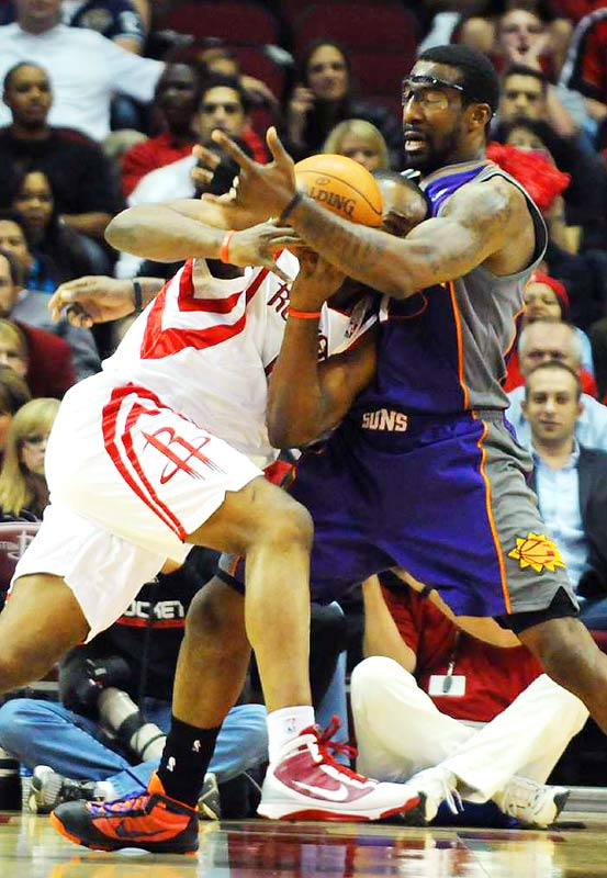 Houston;s Carl Landry runs into the brick wall that is Amare Stoudemire during a 111-105 home loss to the Suns on Nov. 17. Landry had a team-high 27 points and nine rebounds.