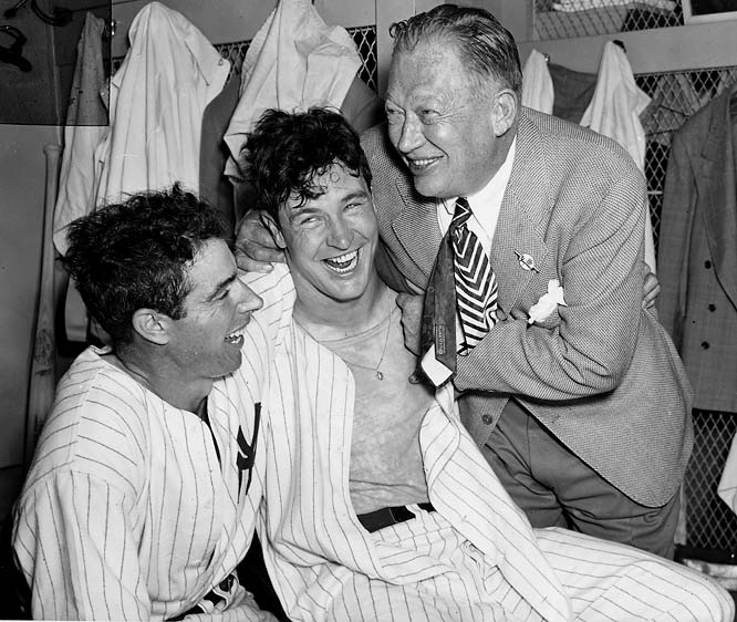 Joe DiMaggio, pitcher Joe Page (who appeared in four games) and GM Larry MacPhail celebrated after a seven-game thriller with Brooklyn known for Yankees hurler Bill Bevens flirting with a no-hitter in Game 4 and Al Gionfriddo's game-saving catch of a DiMaggio drive in Game 6.