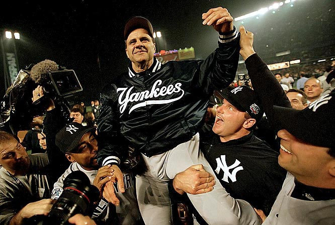 "Manager Joe Torre celebrated his fourth Series championship in five years as his Yankees took down the Mets in five games in New York's first ""Subway Series"" since 1956."