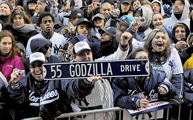Fans celebrate No. 55's dominance in Game 6. Matsui, who was nicknamed Godzilla as a child, batted .274 this season, with 28 home runs and 90 RBIs.