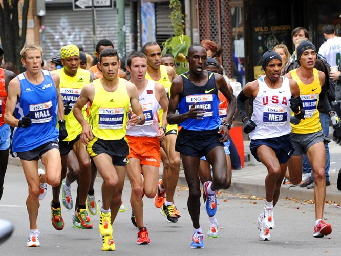 Winner Meb Keflezighi (USA jersey) moved through Brooklyn with the front-runners, including Americans Ryan Hall (left) and Jorge Torres (orange shorts) and Jackson Kotut Kipkoech of Kenya. The 2006 and '08 winner, Marilson Gomes dos Santos (far right), dropped out in the 23rd mile.