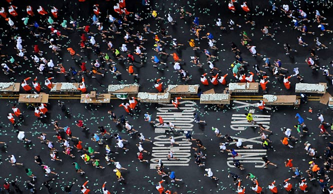 Cups littered Fourth Avenue in Brooklyn as runners grabbed water. Officials said 43,741 people ran the race, which winds through all five boroughs of New York City.