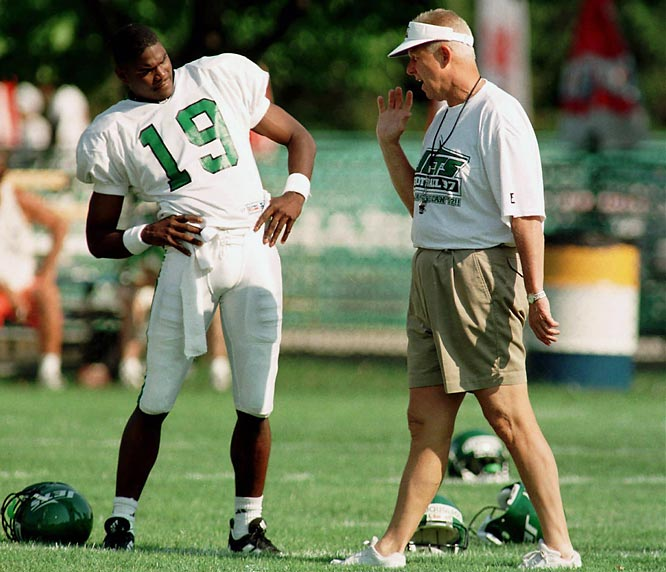 Bill Parcells chats with Keyshawn Johnson during the opening day of Jets training camp in 1997.