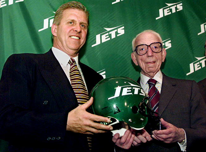 Bill Parcells and Jets owner Leon Hess pose at the team's training camp in Hempstead, N.Y. Parcells was named head coach and chief football operations officer of the New York Jets in 1997.