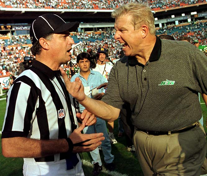 Bill Parcells goes after side judge Mike Pereira at the conclusion of a game against Miami in 1997.