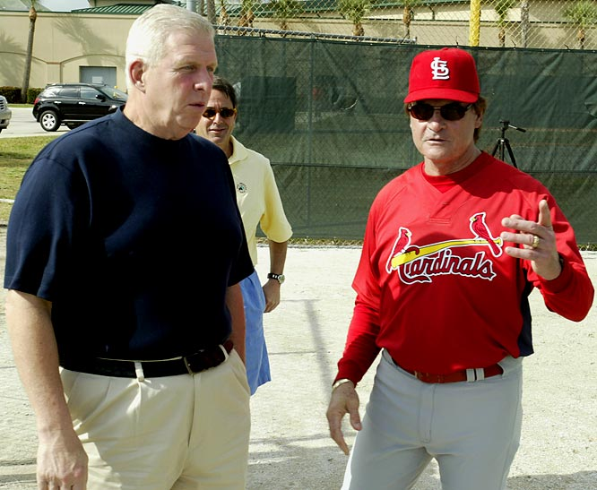 Bill Parcells talks with St. Louis Cardinals coach Tony La Russa during a Cardinals' spring training practice in 2007.