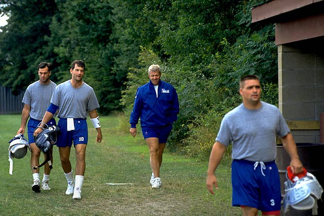 Bill Parcells walks to the Patriots' practice facility during a training camp session in 1993.