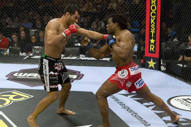 After a slow start, light heavyweight champion Gegard Mousasi (black trunks) and Rameau Thierry Sokoudjou went at it in the second.