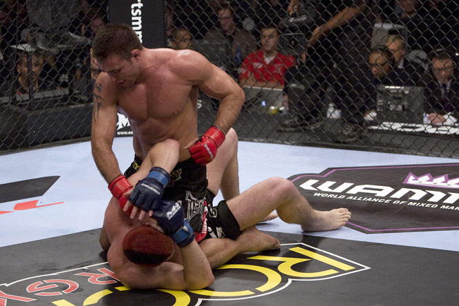 "Two months after Cung Le vacated the middleweight title, Jake Shields (top) snatched it up with a unanimous-decision victory over Jason ""Mayhem"" Miller."
