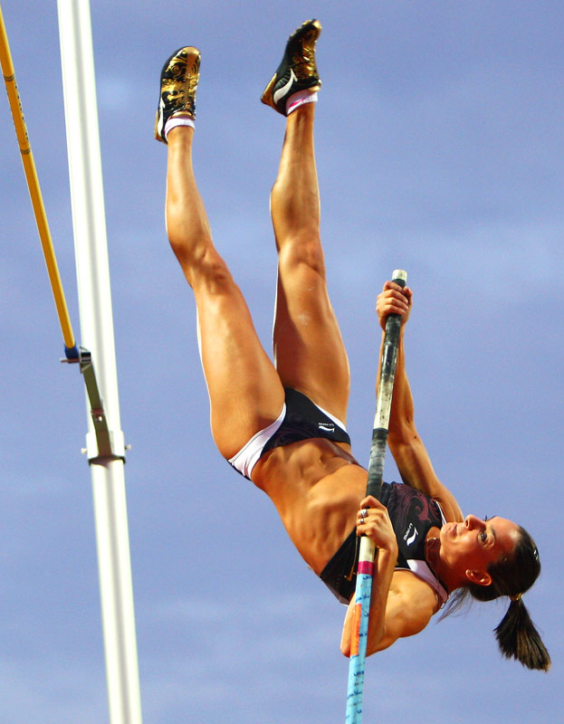 "Yelena Isinbayeva of Russia powered her body up to the bar on the first day of the pole vault competition at the IAAF World Athletics Final in Thessaloniki, Greece, on Sept. 12. She would go on to win the competition by clearing a height of 15' 9"", well below the world record of 16' 7"" she had set in Zurich on Aug. 28. <br><br>""Isinbayeva is always good news for photographers, very charismatic and entertaining and stylish in her technique. She makes good pictures from all angles, but this one from the side shows the strength needed to compete in this tough event."" -- Photographer Michael Steele/Getty Images"