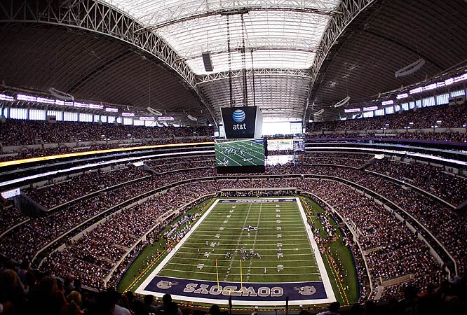 In a region where bigger has always been better, owner Jerry Jones' $1.8 billion shrine to the Dallas Cowboys is the biggest of them all, with a potential capacity of 111,000, including standing room. The greatest feature of the glass-and-steel structure is the world's largest high-definition screen, measuring 11,520 square feet and stretching from 20-yard line to 20-yard line, suspended above the field.