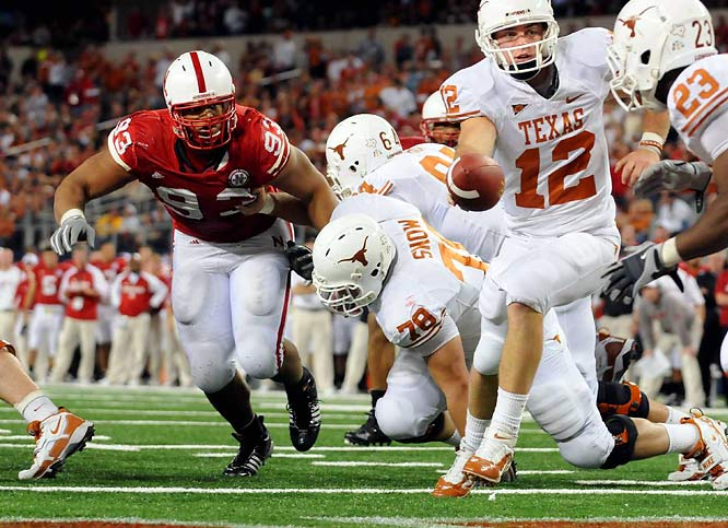 Texas was supposed to blast Nebraska and waltz into the BCS title game, but Suh refused to let the Longhorns ascend so easily. Facing double teams and getting held on almost every play, Suh singlehandedly dismantled one of the nation's best offenses. He finished with 12 tackles (seven for loss) and 4.5 sacks in what would have been an all-time upset had officials not used video replay to discover that one second remained on the clock after Texas quarterback Colt McCoy's final throw hit a stadium railing. The Longhorns kicked a field goal as time expired and won 13-12.